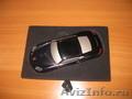 Продается телефон Porsche CaymanS в виде автомобиля